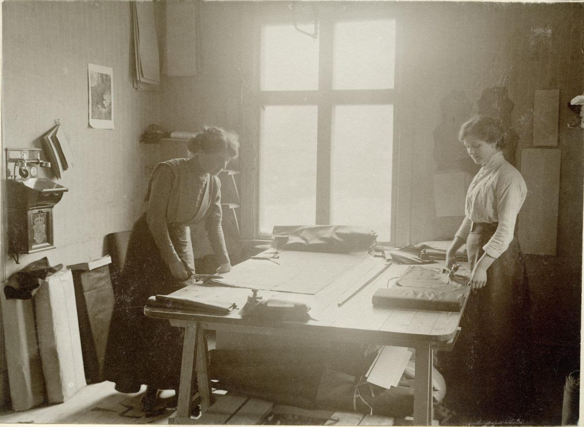 A seamstress cuts fabric